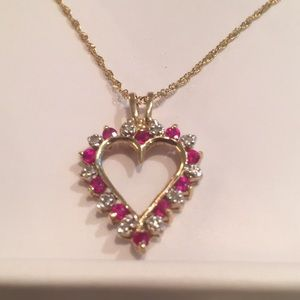 Gold heart necklace with small diamonds and rubies